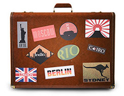 Suitcase covered in location stickers