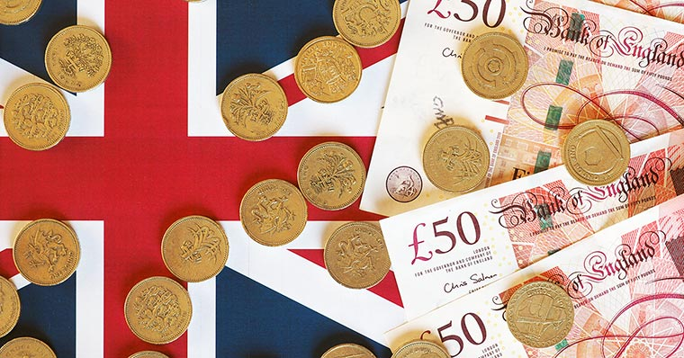 pounds-and-coins-on-flag